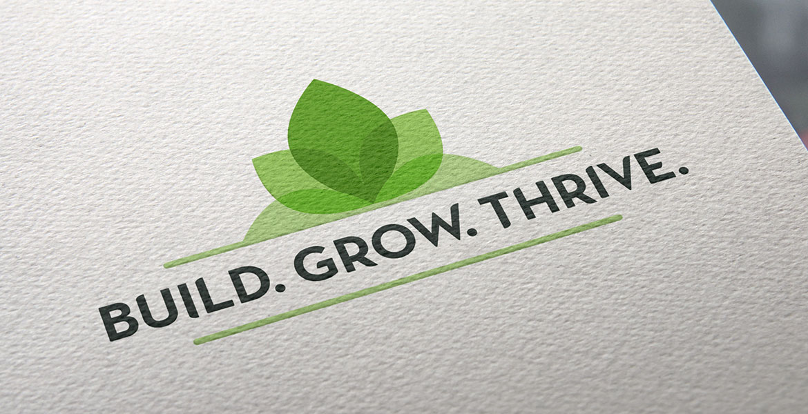 'Build. Grow. Thrive. logo on paper